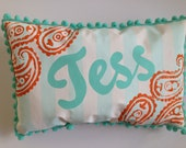 Pillow in light aqua stripes and paisley with personalized name in orange
