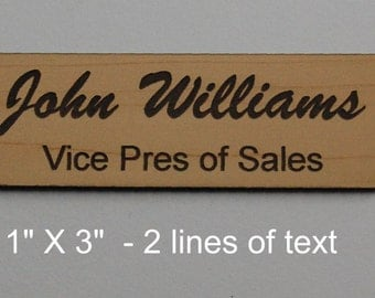"""Laser engraved personalized 1"""" X 3"""" name tags cut from solid 1/16"""" thick plastic with pin or magnetic holders."""