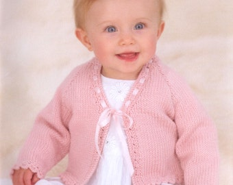 baby knitting pattern for  girls cardigan 2 styles  dk wool birth to 2 years