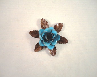 Small Size Decorative Metal Hand Cut and Hand Painted Rustic Blue Color Rose Mounted on a Bed of Leaves.