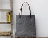 Oversized tote. Thick leather straps. Washed charcoal grey canvas. Yellow cotton stripe lining.