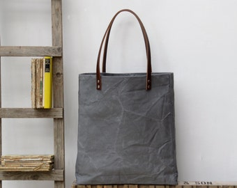Sale now 25 % off. Oversized tote. Thick leather straps. Washed charcoal grey canvas. Yellow cotton stripe lining.
