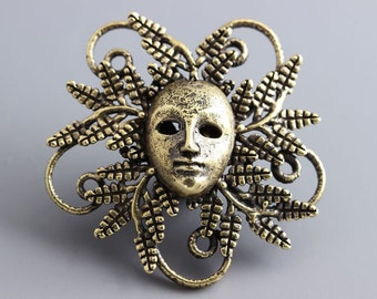 Face in bush, mask, curves, strange object, handmade brass jewelry L2664(1). Designed and made by Anna Bronze.