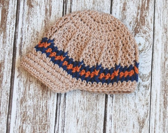 Newsboy crochet hat for baby boys in tan, navy and orange