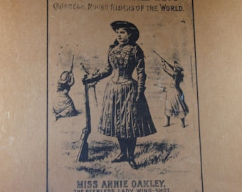 Buffalo Bill's Wild West Show Miss Annie Oakley cowgirl show poster attached to the wooden board