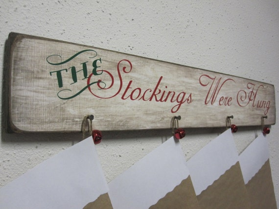 How to hang christmas stockings without a fireplace mantle for Hang stockings staircase
