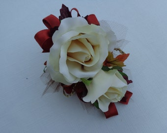Corsage cream roses with fall leaves