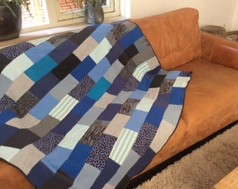 Plaid in blue and grey patchwork