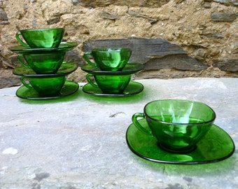 Six French 'vereco' green glass coffee/tea cups and saucers