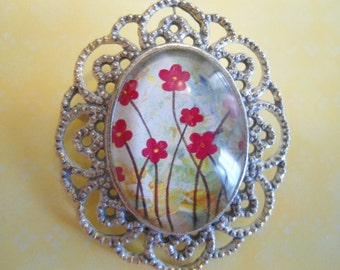 Red flowers on dreamy background brooch:  Antique silver flower glass glass domed filigree cameo brooch