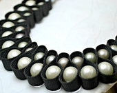 Black ribbon looped pearl necklace.  White and grey pearls double looped with grosgrain ribbon. Statement necklace.