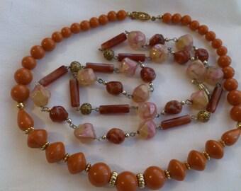 Two Vintage orange bead necklaces