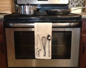 Chef's Tools Dish Towel with Multicolored Border.