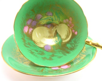 Rare Signed D. Jones Antique Aynsley Tea Cup And Saucer with Fruits, Kelly Green and Gold Tea cup and Saucer.