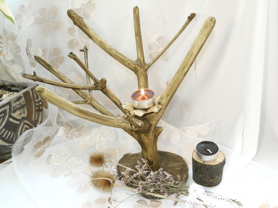 Rustic wood candle holder lighting tree branch by