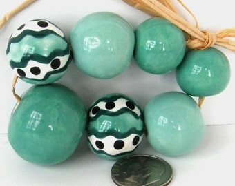 Ceramic bead set in pale jade teal and white