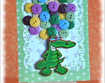 cute crocodile with birthday baloons