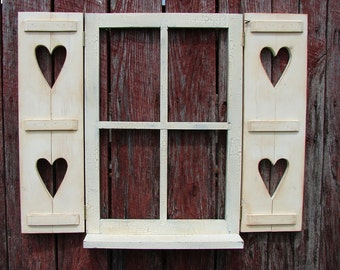 "Window with hinged shutters and shelf, hearts  in shutters 31-1/2"""" wide 24-1/2"" high"