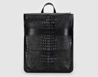 City rectangular backpack-bag with detachable straps.