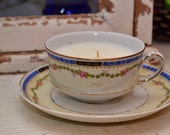 Candle in a vintage a heinrich & co tea cup with saucer