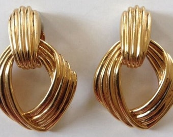 signed ciner large goldtone earrings