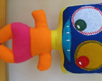 Stuffed monster dolls, soft and cuddly for children of all ages.