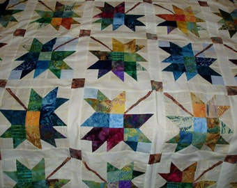 Handquilted twin bed size quilt in Scrappy Maple Leaf design