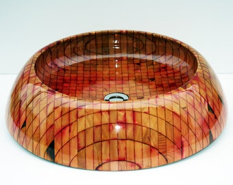 Nipigon round bathroom sink. Exotic wooden sink design