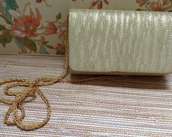 vintage, Gold striped Lame' elegant handbag.  It has a very nice goldtone chain, and a magnetic clasp.