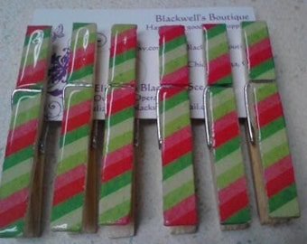 Set of 6 clothes pin magnet clips. Diagonal stripes. Greens, red, and pink.