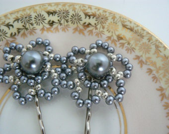 Beautiful beaded hair accessory.  This is perfect to for your wedding up-do. In shades of steel grey pearls.