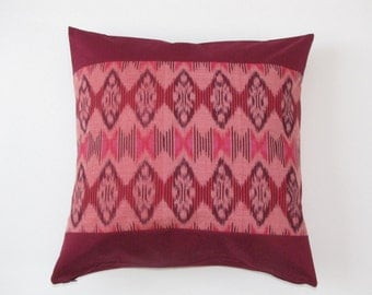 Red and pink ikat pillow case