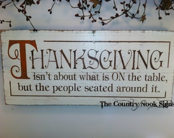 THANKSGIVING.. It's not about the food ON the table... It's about the people seated around it.Painted Wood Sign