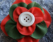 Handmade orange and green stacked flower with button in the middle. - RockabillyBabyPlace