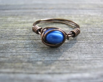 Antique brass and blue pearl wire wrapped ring size 6.5