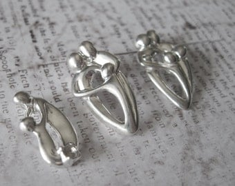 Family or Couple Embracing Charm Vintage Shube's - Made in the USA - Sterling Silver
