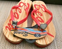 Flip Flop Wedge Sandal Coral with Heart and Square Jewel Embelishment.