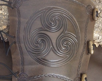 Celtic Swirl,embossed leather Archers bracer, Archery bow arm guard, Antique dyed. Choose your colour.