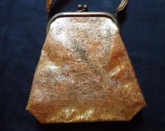 1950's Gold vinyl handbag.