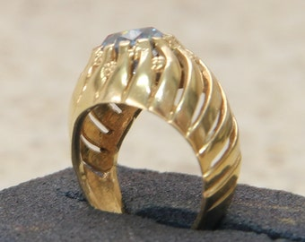 9 ct solid gold dress ring with a light blue center stone