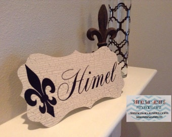 Metal fleur de lis name sign