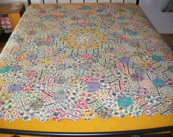 Handmade VINTAGE hand pieced hexagon patchwork, newly remade into a beautiful quilt