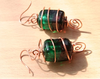 Lampwork Earrings. Copper spiral wire earrings encasing a green and maroon bead Freeform design. Also available in Silver. Art jewellery.
