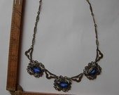 Exceptional 1920s-30s Brass Necklace with Blue Glass Jewels