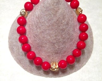 Genuine Coral stretch bracelet with gold plated details