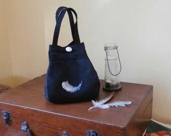 Black fabric handbag . Free shipping Australia.Small handbag. Folds flat for travel. Handpainted feather design. Easy care. Handmade.