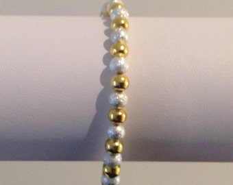 Gold and silver coloured metal balls