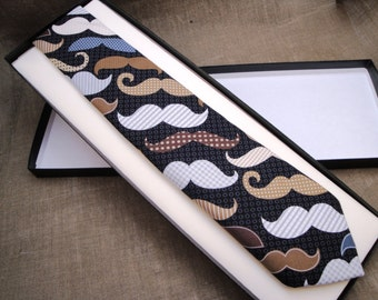 Novelty print neck tie, lots of moustaches on a black background