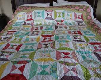 A twin-sized quilt made from Moda Chantilly