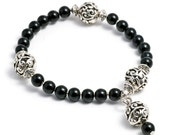 Silver and onyx stone beads stretch bracelet